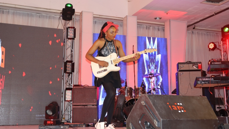 Guitarist, Helen Ibe, performing at BOSS FM 95.5 2020 Valentine's Day Special